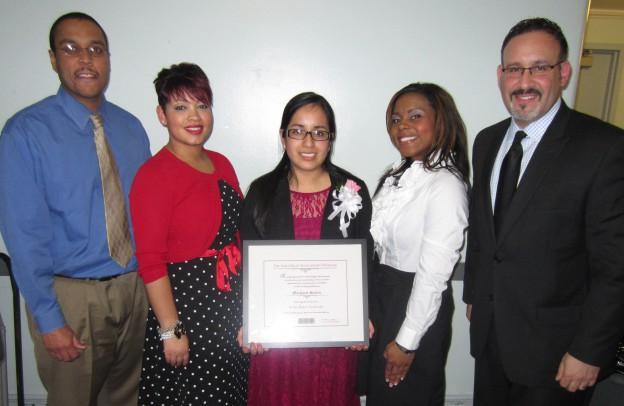 Margaret Seclen, center, with previous recipients, from left, Desi Nesmith, Violet Jiménes Sims, Dr. Santosha Oliver, Dr. Miguel Cardona